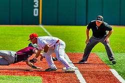 20 May 2019: Tim Catton calls Will LaRue safe at first, but the play is reviewed and it is determined that Jack Butler indeed made the tag for the out.  Missouri Valley Conference Baseball Tournament - Southern Illinois Salukis v Illinois State Redbirds at Duffy Bass Field in Normal IL<br /> <br /> #MVCSPORTS