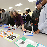 Tupelo Middle School history teacher Teresa Bernauer lays out the sheets to placed around the timeline her students are building at the schools cafeteria as part of the celebration of Mississippi's bicentennial.