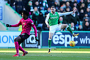 Dedryck Boyata (#20) of Celtic blocks the shot from Martin Boyle (#17) of Hibernian during the Ladbrokes Scottish Premiership match between Hibernian and Celtic at Easter Road, Edinburgh, Scotland on 10 December 2017. Photo by Craig Doyle.