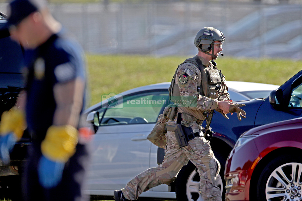 A law enforcement officer rushes toward Stoneman Douglas High School in Parkland, FL, USA, after a shooting on Wednesday, February 14, 2018. Photo by John McCall/Sun Sentinel/TNS/ABACAPRESS.COM