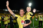 Ben Sigmund of the Phoenix with his six year old son Cameron farewell the fans after his last game for the Phoenix during the A-League - Wellington Phoenix v Western Sydney football match at Westpac Stadium in Wellington on Sunday the 10 April 2016. Copyright Photo by Marty Melville / www.Photosport.nz