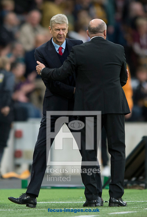 Arsenal manager Arsene Wenger (left) shakes hands with Hull City manager Mike Phelan following the Premier League match at the KCOM Stadium, Hull<br /> Picture by Russell Hart/Focus Images Ltd 07791 688 420<br /> 17/09/2016