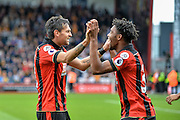 AFC Bournemouth Defender, Charlie Daniels (11) and AFC Bournemouth Midfielder, Jordon Ibe (33) celebrate after taking the lead 1-0 during the Premier League match between Bournemouth and Hull City at the Vitality Stadium, Bournemouth, England on 15 October 2016. Photo by Adam Rivers.