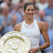 LONDON, ENGLAND - JULY 15:  Garbine Muguruza of Spain with the winners trophy after victory in the Ladies Singles final defeating Venus Williams of The United States during the Wimbledon Lawn Tennis Championships at the All England Lawn Tennis and Croquet Club at Wimbledon on July 15, 2017 in London, England. (Photo by Tim Clayton/Corbis via Getty Images)