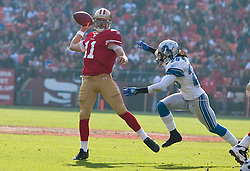 Dec 27, 2009; San Francisco, CA, USA;  Detroit Lions safety Louis Delmas (26) puts pressure on San Francisco 49ers quarterback Alex Smith (11) during the first quarter at Candlestick Park. San Francisco defeated Detroit 20-6.