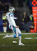 Carolina Panthers punter Brad Nortman (8) punts during the NFL week 19 NFC Divisional Playoff football game against the Seattle Seahawks on Saturday, Jan. 10, 2015 in Seattle. The Seahawks won the game 31-17. ©Paul Anthony Spinelli