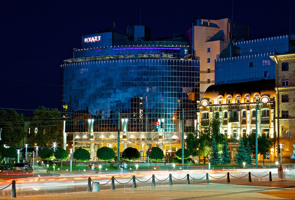 Hyatt hotel in Kyiv, Ukraine. Evening view with street and traffic lights.