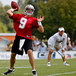 July 29, 2011; Metairie, LA, USA; New Orleans Saints quarterback Drew Brees (9) during the first day of training camp at the New Orleans Saints practice facility. Mandatory Credit: Derick E. Hingle