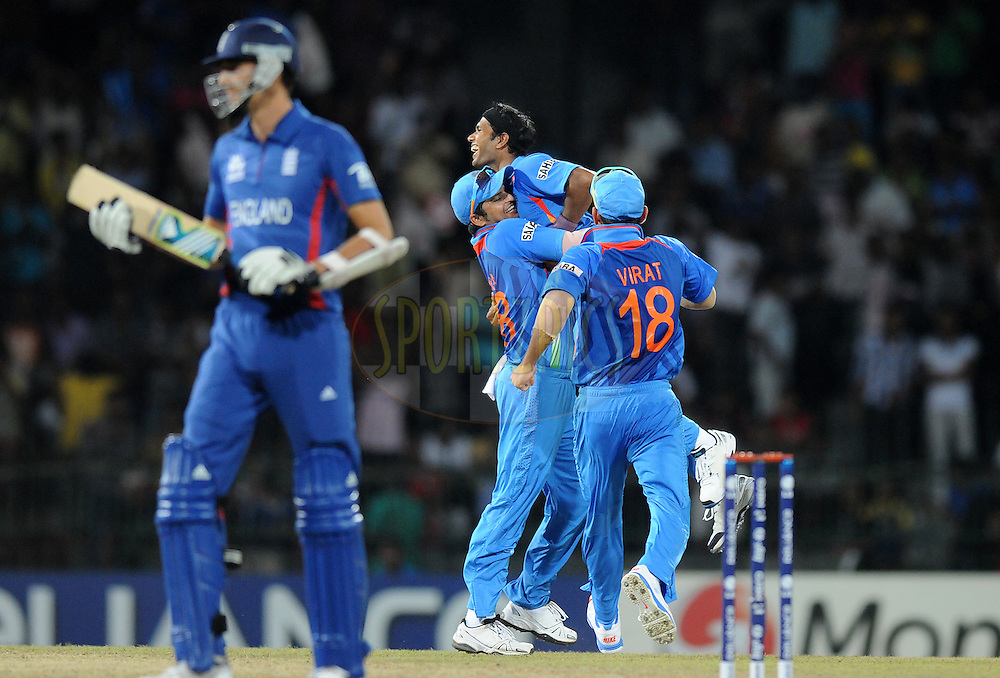 Ashok Dinda of India celebrates the wicket of Stuart Broad Captain of England with teammates as the latter walks back during the 10th WT20 match between  India and England held at the Premadasa cricket stadium in Colombo on 22nd September 2012..Photo by Pal Pillai/Sportzpics..