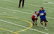 Former NFL Superstar, Doug Flutie jukes from the pressure avoiding the tag during the Celebrity Flag Football match, Super Bowl 51 - 16th Annual Celebrity Flag Football Challenge, Rhodes Stadium,  4 Feb 2017, Katy TX.   Red Team Captain Kirk Cousins would lose for the 2nd straight year to Doug Flutie's Blue team by a final score of 40-35.
