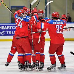 WHITBY, - Dec 17, 2015 -  Game #10 - United States vs. Russia at the 2015 World Junior A Challenge at the Iroquois Park Recreation Complex, ON.  Dmitrii Alekseev #8 of Team Russia celebrates the goal with teammates during the third period.<br /> (Photo: Shawn Muir / OJHL Images)