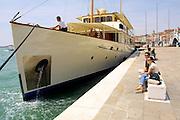 VENICE, ITALY..49th Biennale of Venice.Yachts of art moghuls anchored at Riva degli Schiavoni..(Photo by Heimo Aga)