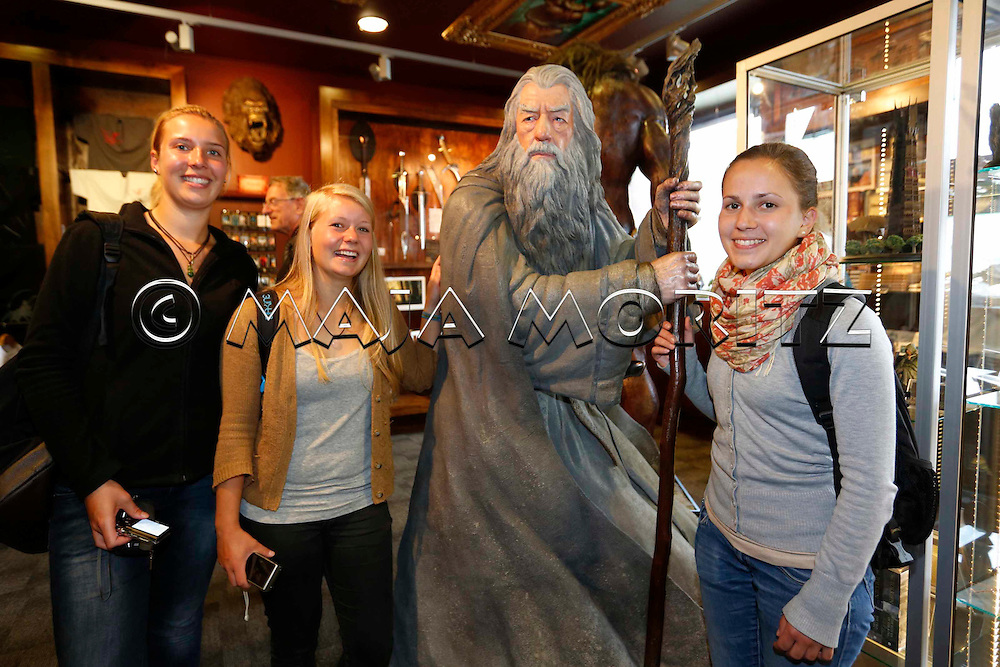 "Gandalf, the wizard, enthralls everyone, here in the Weta Cave, the showroom of the Weta Workshop, where the animations for the Hobbit movies are made, the first movie of the new trilogy  ""The Hobbit: An Unexpected Journey"" starts in cinemas on 12 December 2012, the German tourists (from left) Lena Schuler, Anna-Maria Bachleitner and Lara-Marie Schwineköper take pictures with the magician"