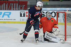10.11.2013, Olympiaeisstadion, Muenchen, GER, Deutschlandcup 2013, USA vs Deutschland, im Bild Peter Mueller, USA, Dimitri Paetzold, Goalkeeper, Team GER, v li // during the Deutschlandcup 2013 ice hockey match between USA and Germany at the Olympiaeisstadion in Muenchen, Germany on 2013/11/10. EXPA Pictures © 2013, PhotoCredit: EXPA/ Eibner-Pressefoto/ Buthmann<br /> <br /> *****ATTENTION - OUT of GER*****