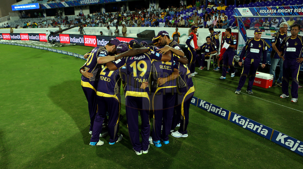 Team players of Kolkata Knight Riders huddle during match 1 of the Oppo Champions League Twenty20 between the Kolkata Knight Riders and the Chennai Superkings held at the Rajiv Gandhi Cricket Stadium, Hyderabad, India on the 17th September 2014<br /> <br /> Photo by:  Sandeep Shetty / Sportzpics/ CLT20<br /> <br /> <br /> Image use is subject to the terms and conditions as laid out by the BCCI/ CLT20.  The terms and conditions can be downloaded here:<br /> <br /> http://sportzpics.photoshelter.com/gallery/CLT20-Image-Terms-and-Conditions-2014/G0000IfNJn535VPU/C0000QhhKadWcjYs
