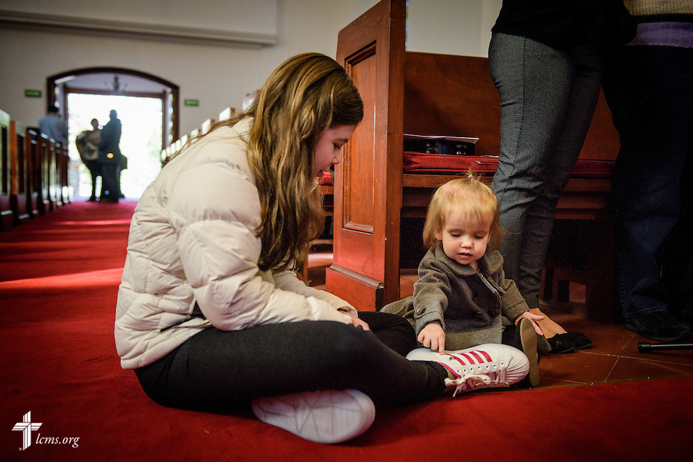 Camila Potter plays with Charlotte Schlund as the choir practices before worship at the Lutheran Church of The Good Shepherd on Sunday, Jan. 15, 2017, in Mexico City. LCMS Communications/Erik M. Lunsford