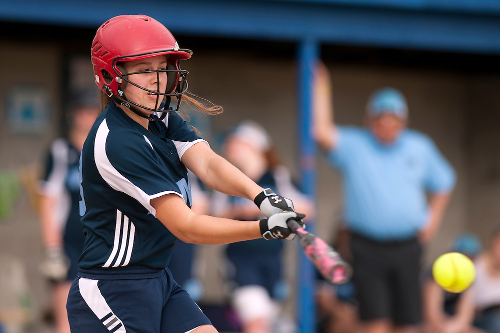 MMU's Felicia Forsyth hits the ball during the girls softball game between BFA-St. Albans and Mount Mansfield at MMU High School on Thursday afternoon May 8, 2014 in Jericho, Vermont. (BRIAN JENKINS, for the Free Press)