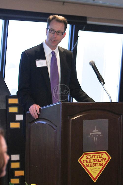 "Seattle Children's Museum Corporate Breakfast 2012. ""The Power of One. The Power of Many.""  Joseph Hagar, Chairman."