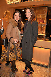 Left to right, LILY LEWIS and KATY LONG at the opening party for Moynat's new Maison de Vente in Mayfair at 112 Mount Street, London W1 on 12th March 2014.