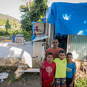 AUGUST 27, 2018--PATILLAS---PUERTO RICO--<br /> Reinaldo Rivera Rivera, 44, stands by the roofless house he shares with his three young sons in Patillas. Rivera says a church group will help re build his house in October. His boys, from left; Yoaniel Rivera Ortiz, 11, Rey Yadiel Rivera Ortiz, 12, and Yarielnaldo Rivera Ortiz, 14.<br /> (Photo by Angel Valentin/Freelance)