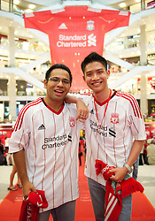 KUALA LUMPUR, MALAYSIA - Friday, July 15, 2011: Liverpool supporters Hamlin and Joe from Malaysia at the Standard Chartered Liverpool fan event at the Pavillion Shopping Centre on day five of the club's Asia Tour. (Photo by David Rawcliffe/Propaganda)