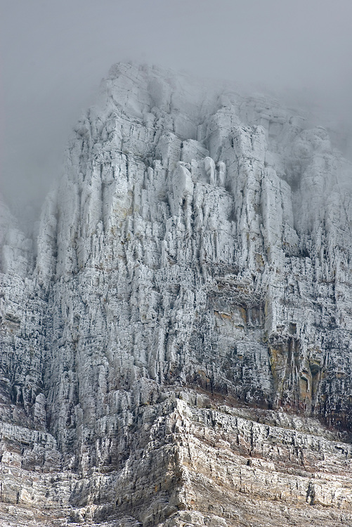 The Garden Wall of Glacier National Park Montana encrusted in rime and ice of autumn snowstorm