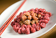 "White and red umeboshi (often referred to in English as ""pickled plums) are arranged for a photo. Photographer: Robert Gilhooly"