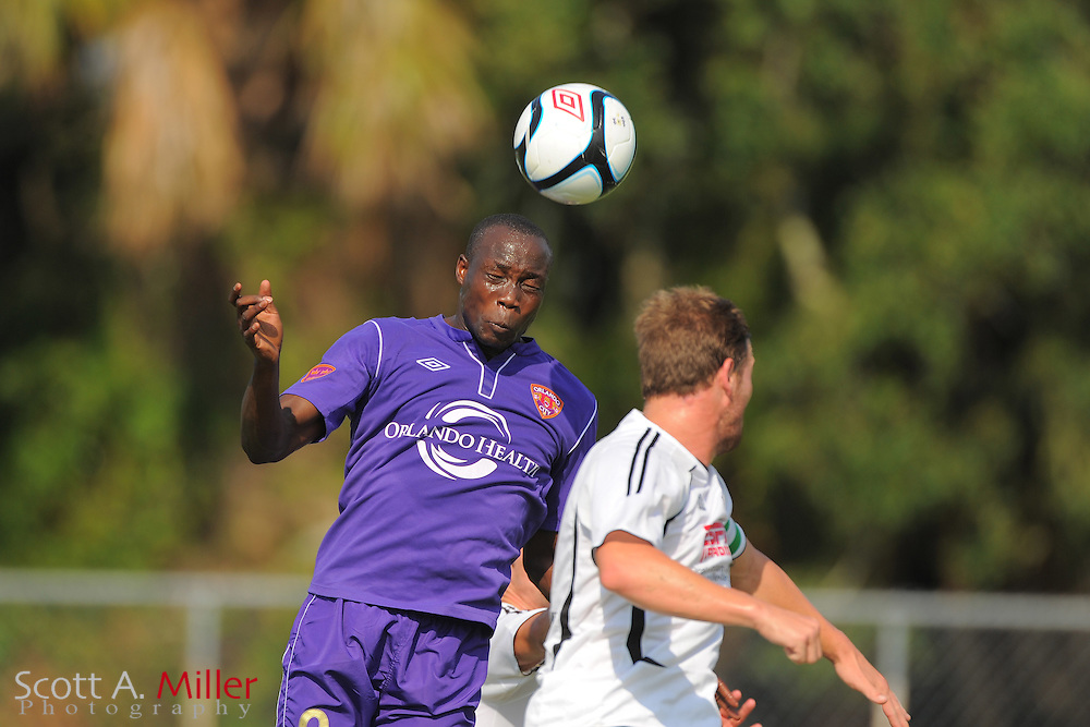 Orlando City U23s forward Moses Aduny (9) goes airborne for the ball during Orlando's game against the Ocala Stampede at the Seminole Soccer Complex Saturday on May 26, 2012 in Sanford, Fla. ...©2012 Scott A. Miller..