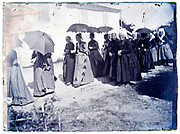 women walking in traditional clothing France 1900s
