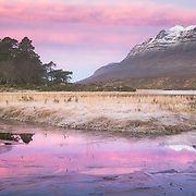 A frosty and cold morning spent in the dark by the banks of loch Clair was rewarded with a wonderful pink light that saturated the scene
