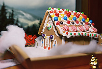 Christmas includes the decorating of a gingerbread house with candies and icing