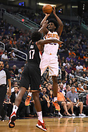 Oct 11, 2017; Phoenix, AZ, USA; Phoenix Suns forward Josh Jackson (20) shoots the ball over Portland Trail Blazers forward Ed Davis (17) in the first half at Talking Stick Resort Arena. Mandatory Credit: Jennifer Stewart-USA TODAY Sports