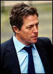 British actor Hugh Grant arrives at the Levenson inquiry into the practises of the British Press at the High court in London Monday Nov. 21, 201, Photo by morn/ i-Images