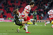 Doncaster Rovers Forward John Marquis (9) fouls Bristol Rovers Midfielder Stuart Sinclair during the EFL Sky Bet League 1 match between Doncaster Rovers and Bristol Rovers at the Keepmoat Stadium, Doncaster, England on 27 January 2018. Photo by Craig Zadoroznyj.