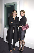 Yara Lapidus and Helene Natter. Vertu phone launch. Musee de Art Moderne de la Ville de Paris. 21 Jan 2002. © Copyright Photograph by Dafydd Jones 66 Stockwell Park Rd. London SW9 0DA Tel 020 7733 0108 www.dafjones.com