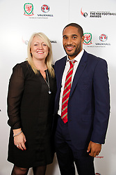 CARDIFF, WALES - Monday, October 6, 2014: Wales' captain Ashley Williams and Vauxhall's Cheryl Stibbs at the FAW Footballer of the Year Awards 2014 held at the St. David's Hotel. (Pic by David Rawcliffe/Propaganda)