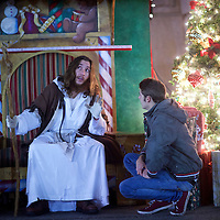 "Michael Hartley, 21, visiting from England, listens to counsel by Michael Grant, 28, ""Philly Jesus,"" in Philadelphia, PA on December 14, 2014.  Nearly everyday for the last 8 months, Grant has dressed as Jesus Christ, and walked the streets of Philadelphia to share the Christian gospel by example.  He quickly acquired the nickname of ""Philly Jesus,"" which he has gone by ever since. REUTERS/Mark Makela (UNITED STATES)"