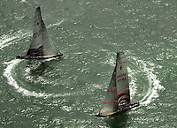 THE BOATS PREPARE FOR THE START AS THEY CIRCLE AROUND EACH OTHER VISIONING THE IDEAL START.