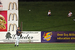 12 August 2011: Tyler McNeely pulls in a fly to left during a game between the Rockford River Hawks and the Normal Cornbelters at the Corn Crib in Normal Illinois.