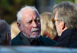© London News Pictures. 05/11/2014. English singer, songwriter GARY BROOKER MBE talking to ERIC CLAPTON while attending the funeral Jack Bruce at Golders Green Crematorium in North London. Jack Bruce was the lead singer and bass player for British Rock band Creme, alongside Eric Clapton and Ginger Baker. Creme sold over 15 million albums worldwide and were widely considered to be the worlds first successful supergroup. Photo credit : Ben Cawthra/LNP