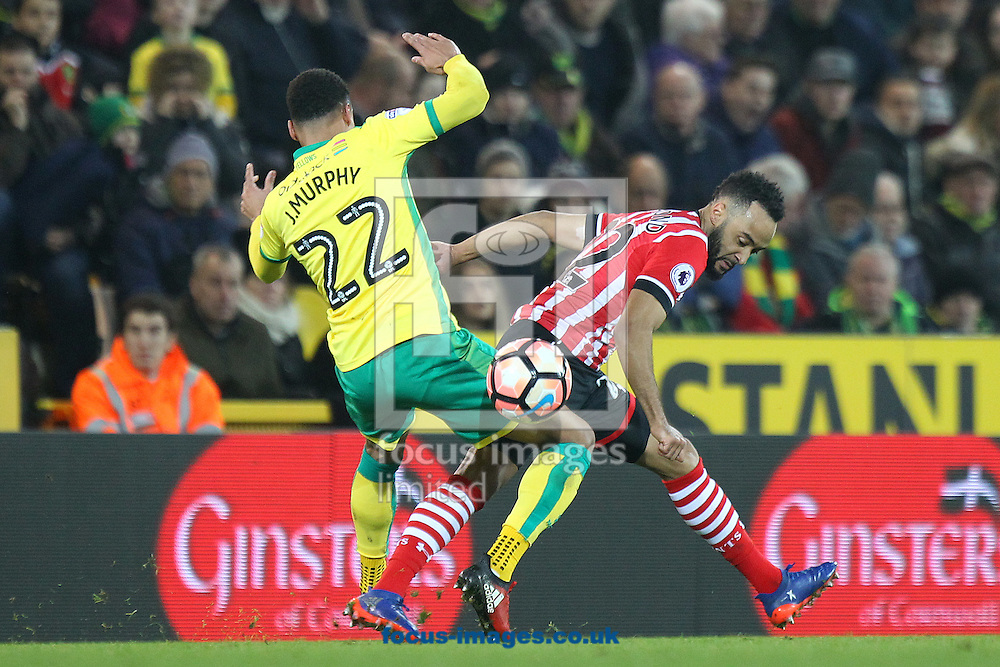 Jacob Murphy of Norwich and former Canary Nathan Redmond of Southampton in action during the third round of the FA Cup at Carrow Road, Norwich<br /> Picture by Paul Chesterton/Focus Images Ltd +44 7904 640267<br /> 07/01/2017