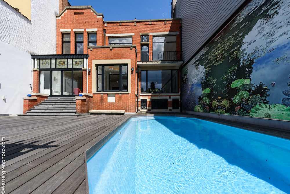 21 Avenue de l'Echevinage, 1180 Uccle, Belgium. The back of the house includignthe terrace and the pool. Ground floor.