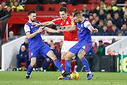 Middlesbrough midfielder Stewart Downing (19) is tackled by Ipswich Town defender Luke Chambers (4) and Ipswich Town midfielder Gwion Edwards (7)  during the EFL Sky Bet Championship match between Middlesbrough and Ipswich Town at the Riverside Stadium, Middlesbrough, England on 29 December 2018.