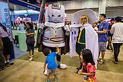 11 MAY 2014 - BANGKOK, THAILAND: A boy checks out the armor of a manga character at Thailand Comic Con at Siam Paragon Mall in Bangkok.    PHOTO BY JACK KURTZ