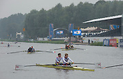 Amsterdam. NETHERLANDS. GBR LM2-. Jonathan CLEGG and Sam SCRIMGEOUR Tuesday morning training, wet and misty.   2014 FISA  World Rowing. Championships.  De Bosbaan Rowing Course . 09:10:15  Tuesday  26/08/2014  [Mandatory Credit; Peter Spurrier/Intersport-images]