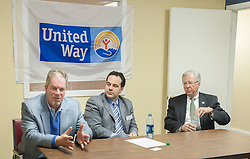 Jack Terrell, left, describes changes that will take place with the merger of Lakes Region United Way and Granite United Way.  To Terrell's left are Patrick Tufts of Granite United Way and Mark Primeau of Bank of NH.  (Alan MacRae/for the Laconia Daily Sun)