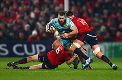 Luke Cowan-Dickie of Exeter Chiefs is tackled by Stephen Archer and Billy Holland of Munster Rugby - Mandatory by-line: Ken Sutton/JMP - 19/01/2019 - RUGBY - Thomond Park - Limerick,  - Munster Rugby v Exeter Chiefs -