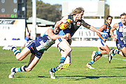 WAFL Elimination Final - Peel Thunder v East Perth Royals at Bendigo Bank Stadium, Mandurah. Photo by Daniel Wilkins. PICTURED- Peel's Alex Silvagni lays a strong tackle on East Perth's Tom Lamb