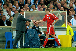 MARSEILLE, FRANCE - Tuesday, September 16, 2008: Liverpool's captain Steven Gerrard MBE  shakes hands with manager Rafael Benitez after his two goals helped beat Olympique de Marseille during the opening UEFA Champions League Group D match at the Stade Velodrome. (Photo by David Rawcliffe/Propaganda)