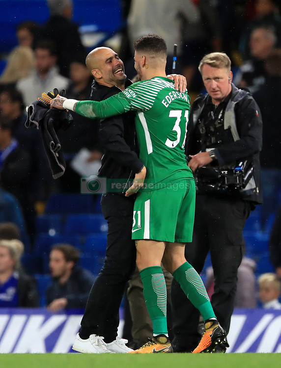 Manchester City manager Pep Guardiola greets goalkeeper Ederson after the final whistle during the Premier League match at Stamford Bridge, London.
